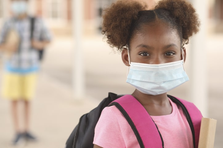 child going back to school during pandemic