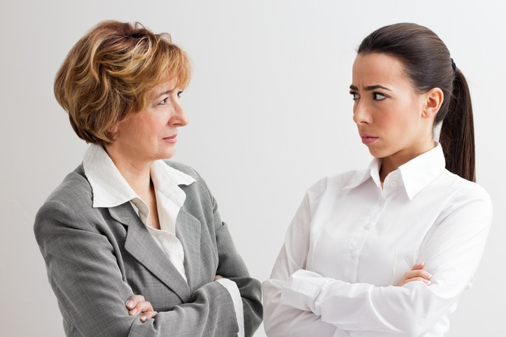 older woman gaslighting a coworker