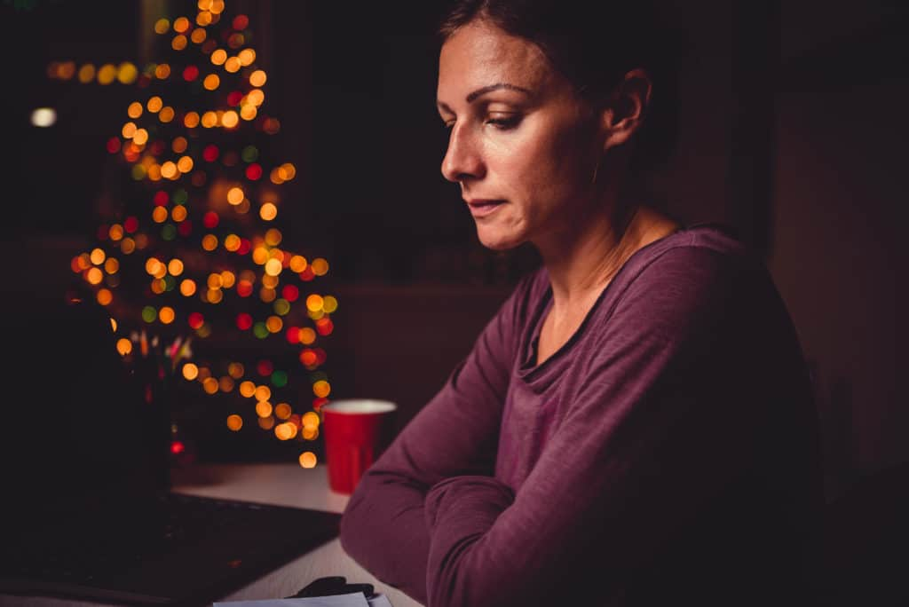 woman appears sad during holidays
