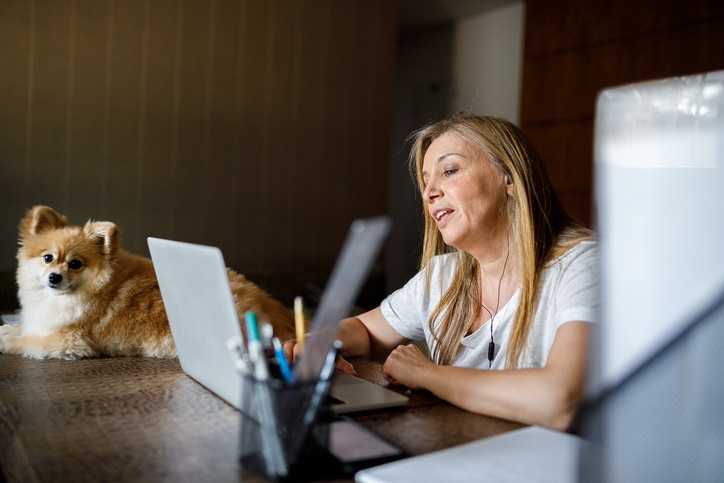 woman on virtual counseling appointment with dog
